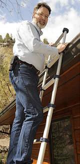 Terry inspecting a roof in the Black Hills area for Rushmore Inspections